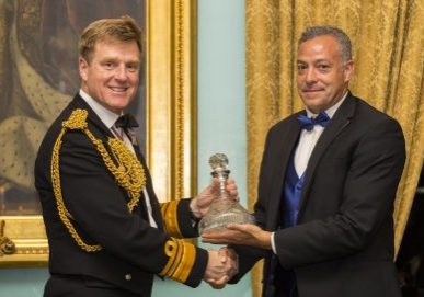 Vice Admiral Ben Key CBE presents Ian Urbina